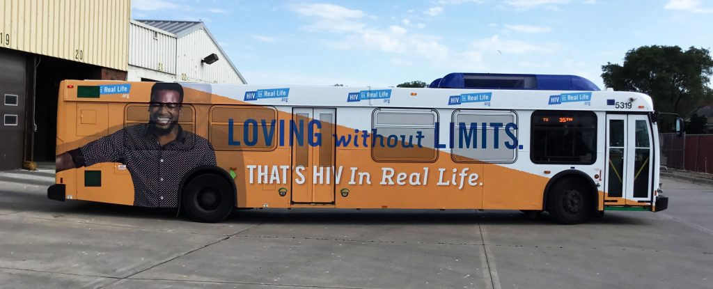 A bus with the HIV campaign's slogan on the side